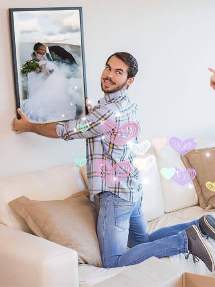 Bryllupsbilder på veggen